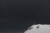 Monte Autore summit, on a dark cloudy sky