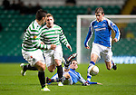 Celtic v St Johnstone...30.10.12      Scottish Communities Cup.Kevin Moon and Murray Davidson tackle Kris Commons.Picture by Graeme Hart..Copyright Perthshire Picture Agency.Tel: 01738 623350  Mobile: 07990 594431
