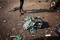 Computer circuit boards begin to pile up at Agbogbloshie dump, which has become a dumping ground for computers and electronic waste from all over the developed world. Hundreds of tons of e-waste end up here every month. It is broken apart, and those components that can be sold on, are salvaged.