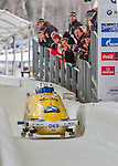 9 January 2016: Germany pilot Francesco Friedrich leads his 4-man team as they cross the finish line after their second run of the day at the BMW IBSF World Cup Bobsled Championships at the Olympic Sports Track in Lake Placid, New York, USA. Friedrich's team ended the day in 6th place with a 2-run combined time of 1:50.19. Mandatory Credit: Ed Wolfstein Photo *** RAW (NEF) Image File Available ***