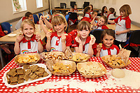 Rainbows learn to make bread at ASDA Newark - pictured from left are Layla Hensell, 6, Livi Curson, 6, Maisie Lyons, 6 and Lily Wilson, 5