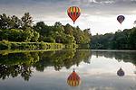 Hot air balloons float above the Ottaquechee River at the Quechee Balloon Fest in Quechee, VT