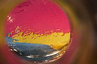 """Beauty at the Bottom: Tequila Sunrise 11"" - This is a photograph of a tequila bottle shot right down inside of the bottle."