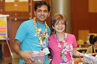 New York, NY, USA - June 24, 2012: Shri Iyer (left) and Tricia Tait display their collection of Origami pins during the OrigamiUSA 2012 convention held at Fashion Institute of Technology in New York City. Attendees designed and made pins to bring to this event and swapped designs with others.