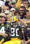 Green Bay's Donald Driver celebrates a 31-yard touchdown catch from Tightend Bubba Franks with a Lambeau Leap. .The Green Bay Packers hosted the Carolina Panthers Sunday September 29, 2002, at Lambeau Field. WSJ/Steve Apps.