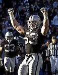 Oakland Raiders linebacker Bill Romanowski (53) celebrates sack on Sunday, December 22, 2002, in Oakland, California. The Raiders defeated the Broncos 28-16.