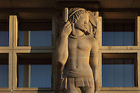 Sculpted pillar with African figure by Pierre Meauze, 1913-1978, on the facade of the Residence Lucien Paye, designed by Jean Vernon, Bruno Philippe and Albert Laprade, 1883-1978, and inaugurated 1949, in the Cite Internationale Universitaire de Paris, in the 14th arrondissement of Paris, France. Originally the Overseas French Territories House, the building was later used to house students from Sub-Saharan African countries. Pierre Meauze sculpted the pillars at the entrance and Anna Quinquaud, 1890-1984, made the bas-reliefs on the facade. The CIUP or Cite U was founded in 1925 after the First World War by Andre Honnorat and Emile Deutsch de la Meurthe to create a place of cooperation and peace amongst students and researchers from around the world. It consists of 5,800 rooms in 40 residences, accepting another 12,000 student residents each year. Picture by Manuel Cohen. L'autorisation de reproduire cette œuvre doit etre demandee aupres de l'ADAGP/Permission to reproduce this work of art must be obtained from DACS.