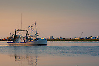 Shrimp trawler in Cameron, Louisiana heading out to sea.