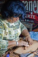 Cuba, Havana.  Partagas Cigar Factory.  Woman Cigar Maker (Torcedor).