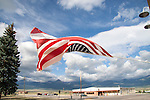 An American flag flutters in the breeze along Main Street in Westcliffe, CO.