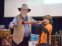 NWA Democrat-Gazette/BEN GOFF @NWABENGOFF<br /> Martin Beggs of Sydney, Australia holds a microphone as 4th grader Kyler Childs tries playing a didjeribone - a type of didgeridoo with a slide like a trombone - Monday, Feb. 13, 2017, during a presentation at R.E. Baker Elementary in Bentonville. Husband and wife Martin and Nellie Beggs have been presenting their 'Australian Kaleidoscope' program at schools in the United States for over ten years for the Kansas City, Mo. company 'The Cultural Kaleidoscope'. Students joined in songs and Aboriginal dances as they learned about the natural and cultural history of 'The Land Down Under' in assemblies and classes throughout the day.