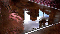 Spindeltop Restaurant reflected in a puddle in Houston, Texas - 2010