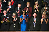 First lady's box guests applaud as United States President Barack Obama delivers his State of the Union Address to a Joint Session of Congress in the U.S. Capitol in Washington, D.C., Tuesday, January 24, 2012.  From left to right top row: Bruce Cochrane (partially obscured), Attorney General Eric Schneiderman, Juan Redin, Debbie Bosanek, Laurene Powell Jobs, and Alicia Boler-Davis.  From left to right bottom row: Admiral William McRaven, U.S. Navy; Jackie Bray; first lady Michelle Obama; Captain Mark Kelly, U.S. Navy (retired); and Dr. Jill Biden. .Credit: Ron Sachs / CNP.(RESTRICTION: NO New York or New Jersey Newspapers or newspapers within a 75 mile radius of New York City)