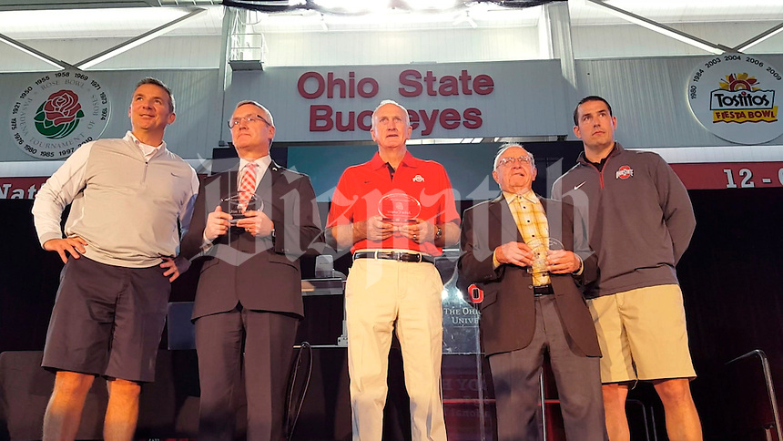 One current and four previous Ohio State head football coaches, L-R, Urban Meyer current coach, Jim Tressel, John Cooper, Earle Bruce and Luke Fickell April 15, 2016, at Ohio State University.  (Columbus Dispatch photo by Tim May)