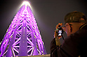 "May 24, 2012, Asakusa, Japan - Visitors take pictures of Tokyo Skytree illuminated in purple which represents the Japanese aesthetic sense, elegant and dignified image of the tower.  ..Tokyo Skytree has two lighting styles, the concept of the design is based on Japanese  aesthetic ""Miyabi"" in purple and blue ""Iki"" represents the essence of Kokoroiki. The tower opened to the public on May 22nd 2012 and at 634m is the worlds' 2nd tallest building and the worlds' tallest tower."
