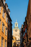 Tower from Church of St. Nicholas - Storkyrkan - Stockholm Cathedral rises between buildings, Gamla Stan - old town, Stockholm, Sweden