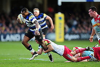 Semesa Rokoduguni of Bath Rugby is tackled by Charlie Mulchrone of Harlequins. Aviva Premiership match, between Bath Rugby and Harlequins on February 18, 2017 at the Recreation Ground in Bath, England. Photo by: Patrick Khachfe / Onside Images