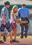 1 September 2013: A Vermont Lake Monsters fan delivers the game ball to the mound in a pizza box prior to a game against the Connecticut Tigers at Centennial Field in Burlington, Vermont. The Lake Monsters fell to the Tigers 6-4 in 10 innings of NY Penn League action. Mandatory Credit: Ed Wolfstein Photo *** RAW Image File Available ****
