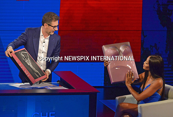 12.03.2017; Milano, Italy: NAOMI CAMPBELL<br /> broke down in tears as she spoke to chat show host Fabio Fazio about the late Italian Vogue editor&nbsp;Franca Sozzani, on the Italian TV show &ldquo;Che Tempo Che Fa&rdquo;.<br /> 46-year-old Naomi, showed off her stunning figure in a jewel-encrusted royal blue gown, featuring a thigh-high split.<br /> Picture Shows: Naomi viewing her bust cast, which comes with the limited edition of the model's self-titled book.<br /> Mandatory Credit Photo: &copy;NEWSPIX INTERNATIONAL<br /> <br /> PHOTO CREDIT MANDATORY!!: NEWSPIX INTERNATIONAL(Failure to credit will incur a surcharge of 100% of reproduction fees)<br /> <br /> IMMEDIATE CONFIRMATION OF USAGE REQUIRED:<br /> Newspix International, 31 Chinnery Hill, Bishop's Stortford, ENGLAND CM23 3PS<br /> Tel:+441279 324672  ; Fax: +441279656877<br /> Mobile:  0777568 1153<br /> e-mail: info@newspixinternational.co.uk<br /> Please refer to usage terms. All Fees Payable To Newspix International