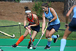 12 September 2014: Syracuse's Lauren Brooks (10) and North Carolina's Samantha Travers (ZIM) (4). The University of North Carolina Tar Heels hosted the Syracuse University Orange at Francis E. Henry Stadium in Chapel Hill, North Carolina in a 2014 NCAA Division I Field Hockey match. UNC won the game 3-0.