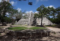 The Ossuary Pyramid, with four stairways on each side, edges sculpted in the form of a serpent with its head resting on the ground at the base of the building, 800-900 AD, Toltec Architecture, Chichen Itza, Yucatan, Mexico. This pyramid was probably used for the cremations. Picture by Manuel Cohen
