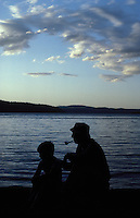 Grandfather with grandson, Lake Cour D' Lane, Idaho.