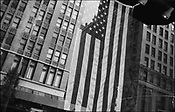American flags fly in many shop and house windows to remember and pay tribute to the victims of the September 11th 2001 terrorist attack on the World Trade Centre buildings in Lower Manhattan by AL-Qaeda terrorists, New York, United States of America.