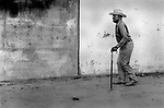 An old male African American with walking stick at the State fair Dallas Texas USA 1999 .