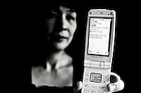 48 year old Hideko Shimamura shows the last email from her late husband, Masayoshi, in Saitama on her mobile phone. He committed suicide in 2009, from depression brought on by excessive overwork. She says, &quot;He called me and said 'I took eleven pills and I'm burning coal briquet but I don't feel sleepy yet.' He called me again later and said, 'I started feeling sleepy finally and becoming unconscious.' The phone was disconnected again. That was the last words from him.&quot;