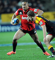 Crusaders Robbie Fruean, left, fends off Chiefs Andrew Horrell in the Super 15 Rugby semi final match, Waikato Stadium, New Zealand, Friday, July 27, 2012. Credit:SNPA / Ross Setford