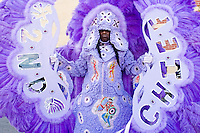 Irvin Scott, the 2nd Chief of the Golden Comanches Mardi Gras Indians, emerges from a house in New Orleans on February 28, 2006.