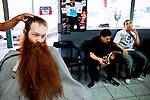 Jack Passion, 25, elicits stares at his local barber shop as he gets a trim in preparation for the 2009 World Beard and Moustache Championships in Anchorage, Alaska. No stranger to the arena of competitive facial hair-growing, Passion and his follicular flair won first place in the full beard: natural category at the 2007 championship in Brighton, England. He has since incorporated, launching a line of organic cotton T-shirts silk-screened with the likeness of his beard and self-publishing a how-to book entitled The Facial Hair Handbook. &quot;Everywhere I go, it starts conversations,&quot; Passion says of his six-year-old beard. &quot;I've gotten a lot of perspective on what it feels like to be looked at all the time.&quot;<br /> <br /> Photographed for the LA Times