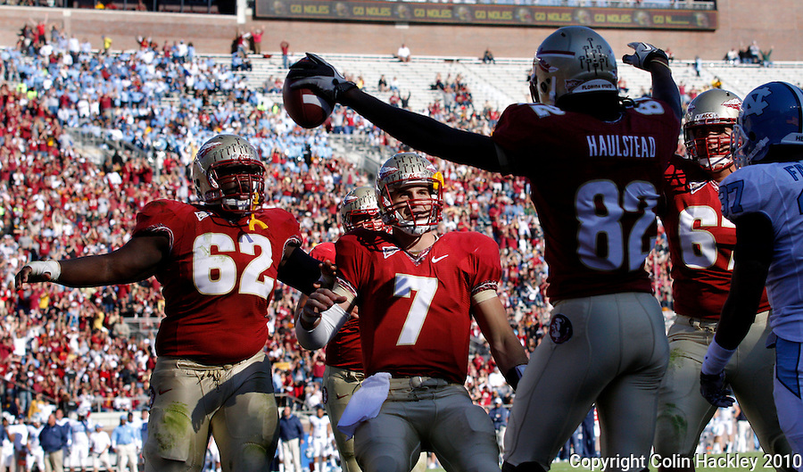 TALLAHASSEE, FL 11/6/10-FSU-NC FB10 CH-Florida State's Rodney Hudson, left, and Christian Ponder celebrate with Willie Haulstead after he scored the Semonle's first touchdown against North Carolina during first half action Saturday at Doak Campbell Stadium in Tallahassee. The Tar Heels beat the Seminoles 37-35. .COLIN HACKLEY PHOTO