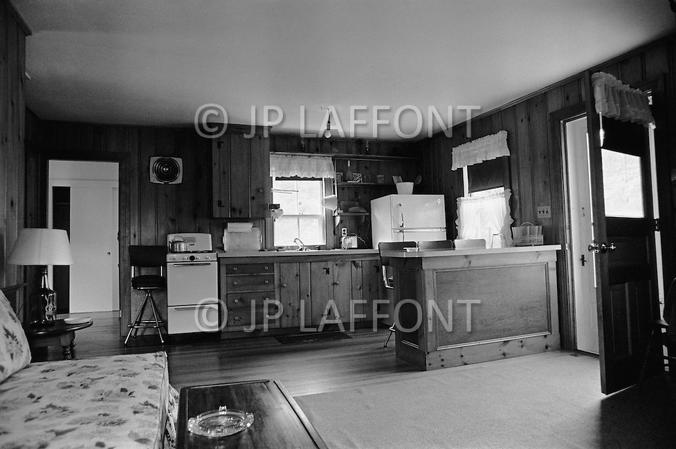 July 19th 1969, Chappaquiddick, Edgartown, Martha's Vineyard, Massachusetts<br /> The living room and kitchen of the summer house on Chappaquiddick Island in 1969 where Senator Edward Ted Kennedy spent the night after he drove a car off a bridge and his aide Mary Jo Kopechne was killed.