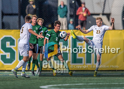 24 September 2016: University of Vermont Catamount Defender Loftur Eriksson, a Graduate from Saudarkrokur, Iceland, battles Dartmouth College Big Green Midfielder/Defender Braden Salvati, a Freshman from Del Mar, CA, at Virtue Field in Burlington, Vermont. The teams played to an overtime 1-1 tie in front of an Alumni Weekend crowd of 1,710 fans. Mandatory Credit: Ed Wolfstein Photo *** RAW (NEF) Image File Available ***
