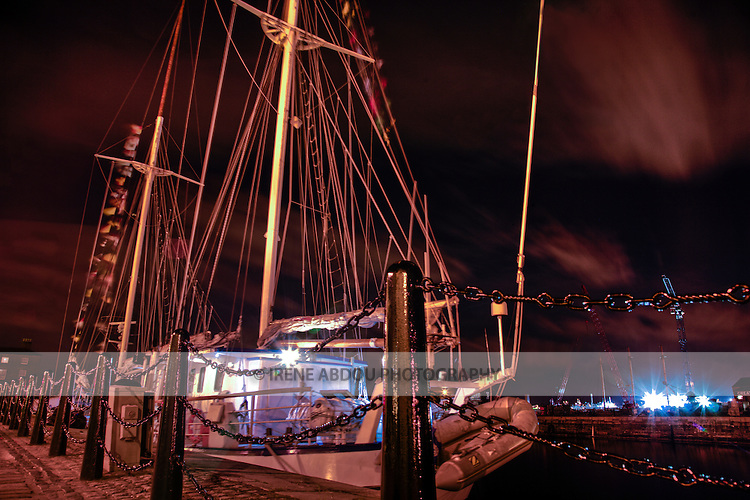 A boat lies moored at Albert Dock, the waterfront of Liverpool, England's 5th most populous city. Albert Dock was named a World Heritage Site in 2004 and boasts the largest number of protected buildings in Britain.