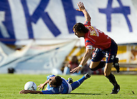 Cruz Azul forward Miguel Sabah is fouled by Veracruz Tiburones Rojos defender Pablo Quatrocchi during their soccer match in the Azul Stadium in Mexico City, April 8, 2006. Cruz Azul won 3-0 to Veracruz. .. Photo by © Javier Rodriguez