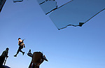After months of setbacks, Libyan rebels stun the world with a swift takeover of the capital,Tripoli.  An armed rebel leaps from a. bronze sculpture of a fist crushing a U.S. fighter plane during celebrations at Qaddafi's Bab Al-Aziziya military compound..