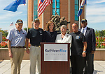 East Meadow, New York, U.S. - September 3, 2014 - At center, KATHLEEN RICE (in black), Democratic congressional candidate (NY-04), and outgoing Representative CAROLYN MCCARTHY (in white) are at Veterans Memorial at Eisenhower Park, after they toured Northport VA Medical Center. Rice released a whitepaper on veterans policy and announced the formation of her campaign's new Veterans Advisory Committee, and 4 of its members participated at the press conference: PAUL ZYDOR, (in blue shirt) of Merrick, U.S. Navy, Korean War Veteran; PAT YNGSTROM, (in black T-shirt and cap) of Merrick, U.S. Army Paratrooper, Vietnam War Veteran; STEVE BONOM, (in black T-shirt and pants) of Massapequa, U.S. Navy, Vietnam War Veteran; and JEREMIAH E. BRYANT, (wearing American Flag tie and black suit) of Rockville Centre, U.S. Army, Vietnam War Veteran. Rice is in her third term as Nassau County District Attorney, Long Island.