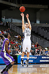 24 MAR 2012:  John Allen (20) of Western Washington University shoots the ball against the University of Montevallo during the Division II Men's Basketball Championship held at the Bank of Kentucky Center in Highland Heights, KY. Western Washington won the title 72-65.  Joe Robbins/NCAA Photos