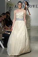 "Model walks runway in a Charity Bridal gown - champange silk taffeta ball gown with crystal and satin faced organza belt, from the Anne Bowen Bridal Spring 2013 ""Coat of Arms"" collection fashion show, during Bridal Fashion Week New York April 2012."