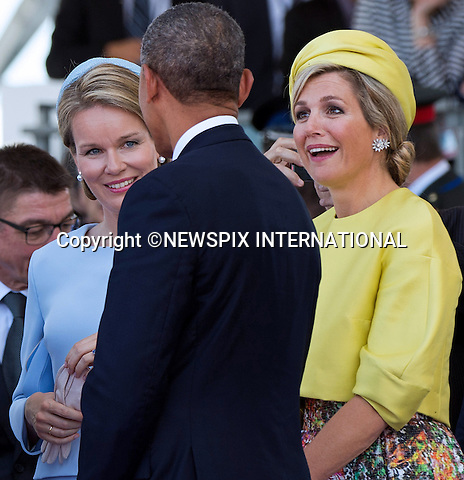 06.06.2014; Ouistreham, FRANCE; 70TH ANNIVERSAY OF LIBERATION<br /> Heads of State and Royalty attend the International Ceremony remembering the D-Day invasion of 6th June 1944, that signaled beginning of the end of the World War ll.<br /> <br /> 70&egrave;me Anniversaire de la Lib&eacute;ration en Normandie - C&eacute;r&eacute;monie Internationale &agrave; Ouistreham, en pr&eacute;sence de Fran&ccedil;ois Hollande, Pr&eacute;sident de la R&eacute;publique fran&ccedil;aise, du Premier ministre et de tous les les chefs de d&eacute;l&eacute;gation.<br /> Those attending included Fran&ccedil;ois Hollande, President of the French Republic, President Barack Obama, Queen Elizabeth II, King Philippe of Belgium, Angela Merkel, Grand Duke of Luxembourg, Henri, King Willem-Alexander of the Netherlands, King Harald V of Norway, Vladimir Putin, Tony Abbott ; Prime Minister of Australia, Stephen Harper ; Prime Minister of Canada, Milos Zeman ; President of the Czech Republic, Queen of Danemark ; Margrethe II, Karolos Papoulias ; President of the Hellenic Republic, Giorgio Napolitano ; President of the Italian Republic, Jerry Mateparae ; Governor-General of New-Zealand, Bronislaw Komorowski ; President of the Republic of Poland, Ivan Gasparovic ; President of the Slovak Republic, Queen Mathilde of Belgium, Prince Albert II of Monaco, Prince Charles, Prince Philip, Camilla, Duchess of Cornwall, Herman Van Rompuy, Elio Di Rupo, Maria Teresa of Luxembourg, Queen Maxima of the Netherlands, David Cameron, Grand Duke Jean of Luxembourg, Erna Solberg, Prime Minister of Norway.<br /> Mandatory Credit Photos:&copy;NEWSPIX INTERNATIONAL<br /> <br /> **ALL FEES PAYABLE TO: &quot;NEWSPIX INTERNATIONAL&quot;**<br /> <br /> PHOTO CREDIT MANDATORY!!: NEWSPIX INTERNATIONAL(Failure to credit will incur a surcharge of 100% of reproduction fees)<br /> <br /> IMMEDIATE CONFIRMATION OF USAGE REQUIRED:<br /> Newspix International, 31 Chinnery Hill, Bishop's Stortford, ENGLAND CM23 3PS<br /> Tel:+441279 324672  ; Fax: +441279656877<br /> Mobile:  0777568 1153<br /> e-mail: info@newspixinternational.co.uk