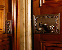 Detail of an ornate door handle and light switch