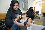 Mothers feed their malnourished children in a feeding program at a clinic in Gaza City supported by DanChurchAid, a member of the ACT Alliance, whose members are supporting health care, vocational training, rehabilitation of housing and water systems, psycho-social care, and other humanitarian actions throughout the besieged territory.