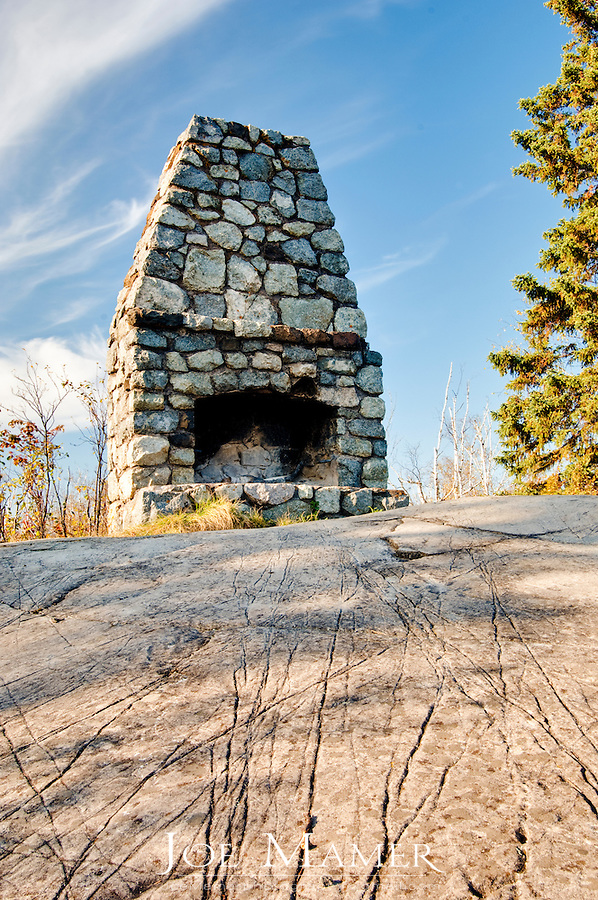 Freestanding stone fireplace atop Day Hill in Minnesota's Split Rock Lighthouse State Park. According to local legend it was the start of a house built around 1900 by Frank Day, a businessman from Duluth, for himself and his sweetheart, but abandoned when she did not reciprocate his love