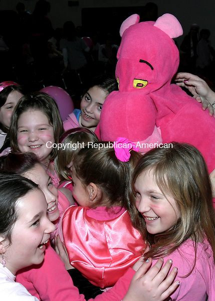 THOMASTON, CT. 20 March 2008-032008SV02--A Pink Panther gets multiple hugs from students during a think pink program at Center School in Thomaston Thursday. This is the 25th anniversary of Think Pink Day in Thomaston schools. The day was founded by Marth MacDonald as a way to accentuate the positive. Students and staff wear as much pink as possible and the PTO had ice cream for all students.<br /> Steven Valenti Republican-American