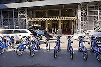 A  CitiBike docking station in Grand Army Plaza, in front of the Plaza Hotel, in New York on Sunday, October 20, 2013.  The hotel is suing Citibank and the city because they feel that the docking station is an eyesore in front of their landmark building, and it takes up a lane of their traffic. (© Richard B. Levine)