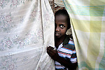 A boy is one of hundreds of earthquake survivors huddled in tents and makeshift shelters in a park in the Nerette area of Petionville, Haiti. Hundreds of thousands of Haitians were left homeless by the January 12 quake.