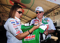 Apr. 13, 2008; Las Vegas, NV, USA: NHRA funny car driver Ashley Force with father John Force during the SummitRacing.com Nationals at The Strip in Las Vegas. Mandatory Credit: Mark J. Rebilas-