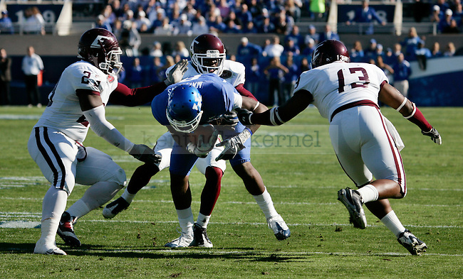 EKU's defense takes down junior wide receiver Chris Matthews in the first half of the UK vs. EKU game on Saturday, Nov. 7, 2009 at Commonwealth Stadium. Photo by Britney McIntosh | Staff